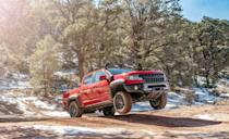"<p>The ZR2 version of the mid-size <a href=""https://www.caranddriver.com/chevrolet/colorado"" rel=""nofollow noopener"" target=""_blank"" data-ylk=""slk:Chevy Colorado"" class=""link rapid-noclick-resp"">Chevy Colorado</a> looks beefier than other Colorados and has serious modifications to back up its appearance. Chevrolet widened the truck's front and rear tracks by 3.5 inches and fitted meaty 31-inch Goodyear Wrangler DuraTrac tires. Front and rear electronic-locking differentials help manage traction from the standard 3.6-liter V-6 or the optional 2.8-liter diesel four-cylinder. The suspension is lifted 2.0 inches and uses Multimatic remote-reservoir shocks, while skid plates protect key underbody components. Even beefier is the ZR2 Bison, which adds tougher bumpers, a winch, skid plates, and a snorkel from AEV.</p>"