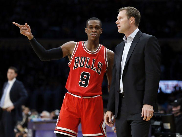 Rajon Rondo points Fred Hoiberg in the right direction. (AP)