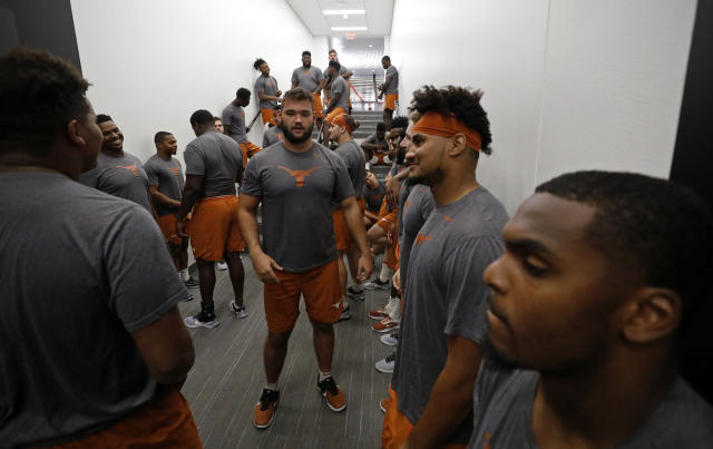 Texas Longhorns football players wait for their morning workout Wednesday Sept. 4, 2019 in Austin, Tx. ( Photo by Edward A. Ornelas )