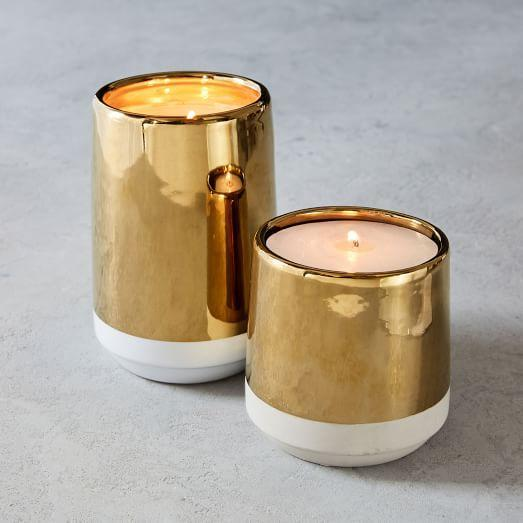 "<p><strong>West Elm</strong></p><p>westelm.com</p><p><strong>$39.00</strong></p><p><a href=""https://www.westelm.com/products/cement-metal-candle-d4686"" rel=""nofollow noopener"" target=""_blank"" data-ylk=""slk:BUY NOW"" class=""link rapid-noclick-resp"">BUY NOW</a></p><p>Get your holiday gleam on with this shiny gold and matte white candle that offers smoky, moody tones of spices and amber. </p>"