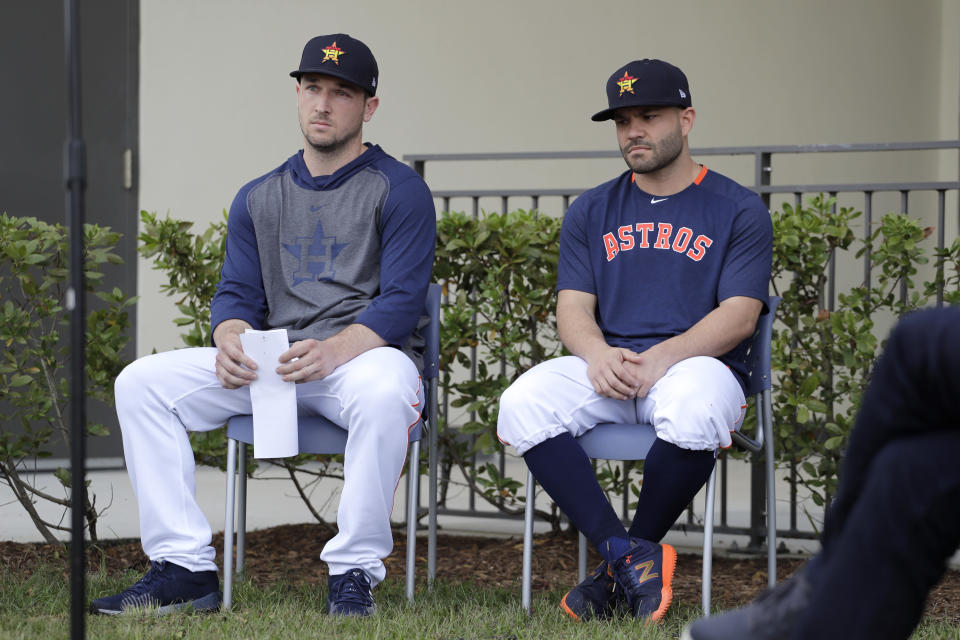 Houston Astros infielder Alex Bregman, left, and teammate Jose Altuve sit in chairs as the wait to deliver statements during a news conference before the start of the first official spring training baseball practice for the team Thursday, Feb. 13, 2020, in West Palm Beach, Fla. (AP Photo/Jeff Roberson)