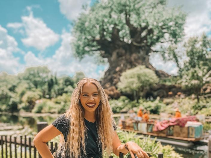 kayleigh price in front of the tree of life at animal kingdom in disney world