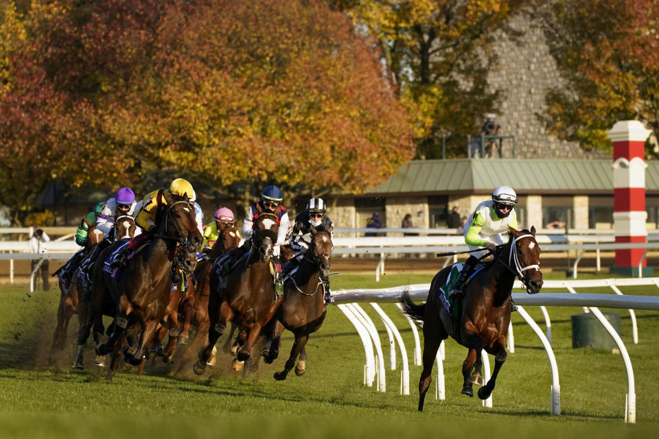 Aunt Pearl, right, ridden by Florent Geroux, leads the field around the first turn on the way to winning the Breeders' Cup Juvenile Fillies Turf horse race at Keeneland Race Course, Friday, Nov. 6, 2020, in Lexington, Ky. (AP Photo/Mark Humphrey)