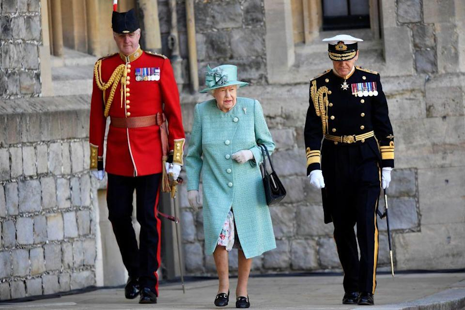 """<p>Queen Elizabeth has been spending lockdown at Windsor Castle with Prince Philip. In May, <a href=""""https://www.thetimes.co.uk/article/coronavirus-queen-to-leave-public-stage-for-months-888303fnp"""" rel=""""nofollow noopener"""" target=""""_blank"""" data-ylk=""""slk:The Sunday Times"""" class=""""link rapid-noclick-resp""""><em>The Sunday Times</em></a> reported that the queen """"will remain at Windsor Castle indefinitely,"""" and that it could be some time before the monarch returns to her official duties amid the coronavirus pandemic.</p>"""