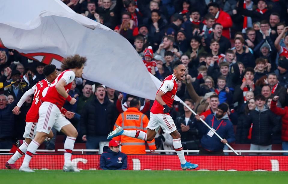"""Soccer Football - Premier League - Arsenal v Chelsea - Emirates Stadium, London, Britain - December 29, 2019 Arsenal's Pierre-Emerick Aubameyang celebrates scoring their first goal REUTERS/Eddie Keogh  EDITORIAL USE ONLY. No use with unauthorized audio, video, data, fixture lists, club/league logos or """"live"""" services. Online in-match use limited to 75 images, no video emulation. No use in betting, games or single club/league/player publications.  Please contact your account representative for further details."""