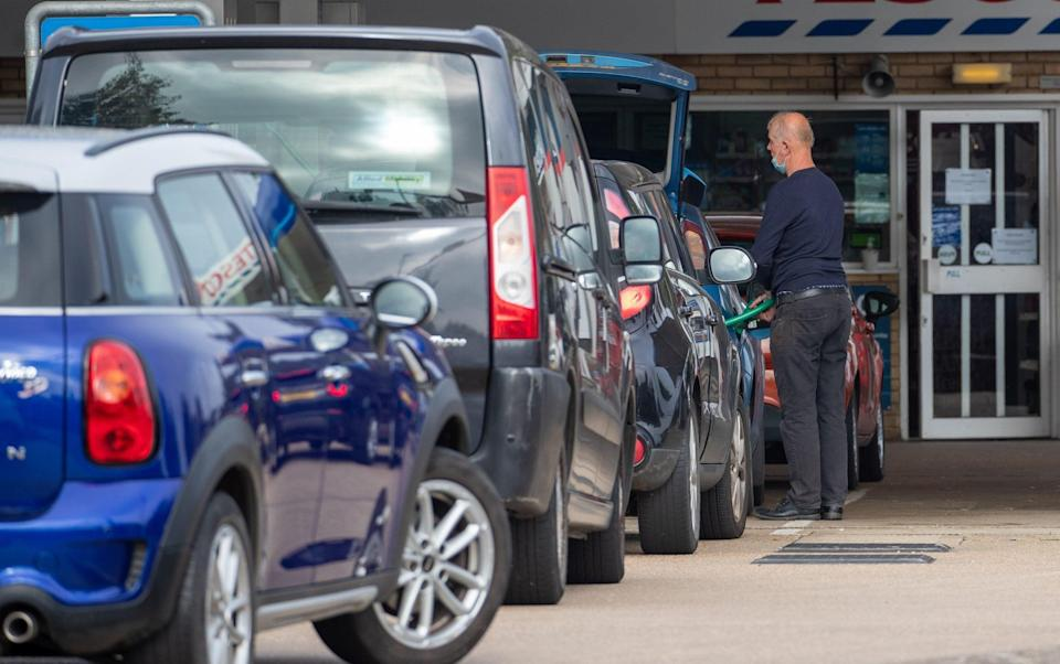 Queues for fuel at the Tesco petrol station in Ely, Cambridgeshire, on Friday morning - Geoff Robinson