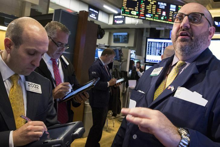 Specialist trader Peter Giacchi gives a price just before the opening bell on the floor of the New York Stock Exchange