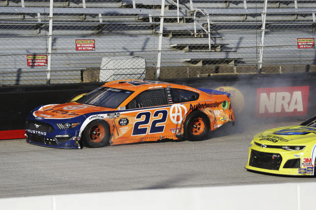 Joey Logano (22) drives the final lap in a NASCAR Cup Series auto race at Bristol Motor Speedway Sunday, May 31, 2020, in Bristol, Tenn. Logano had taken the lead but collided with Chase Elliott with three laps remaining. Their cars made contact in the fourth turn and drifted into the wall, allowing Brad Keselowski to come from third place for the win. (AP Photo/Mark Humphrey)