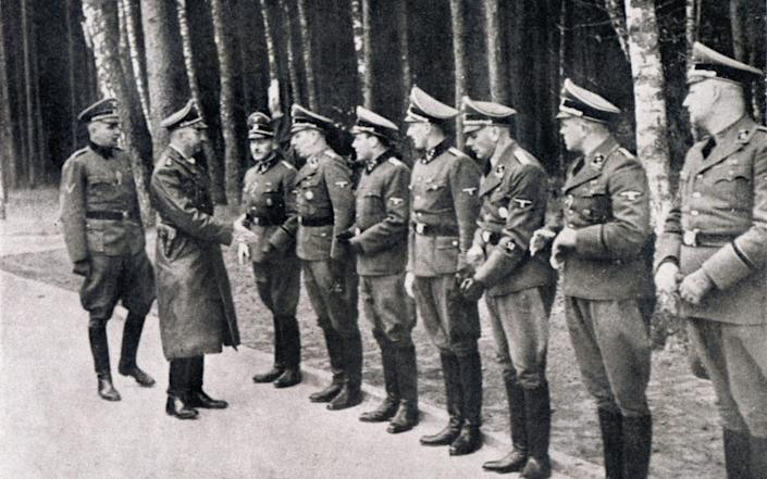 STUTTHOF (1939-1945) Visit by Himmler: he is reviewing SS instance to the field. The Germans settled at Stutthof in September 1939, a wooded area west of Stutthof (Sztutowo), a small town about 22 miles east of Danzig (Gdansk). Initially it was a camp of civilians under the direction of the police of Gdansk, in November 1941, he became a labor camp run by the German police in January 1942 and then became a concentration camp. Official/propaganda photograph, November 23, 1941 - akg-images / Fototeca Gilardi