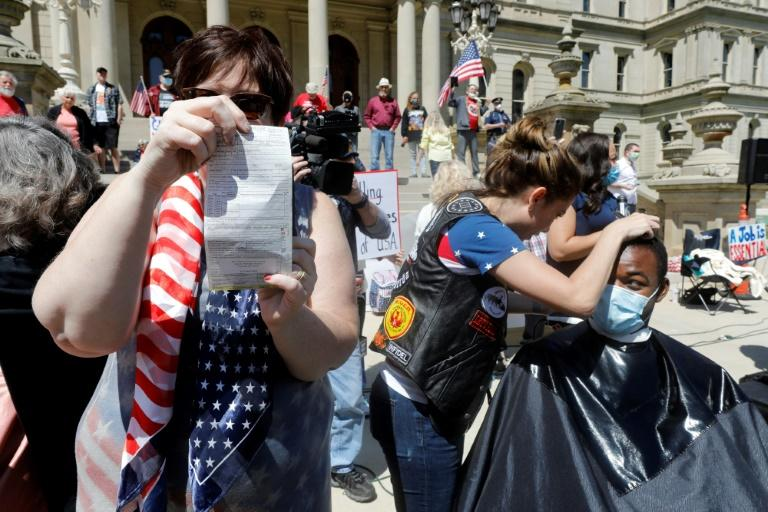Police issued tickets for disorderly conduct to some of the barbers at the Michigan protest (AFP Photo/JEFF KOWALSKY)