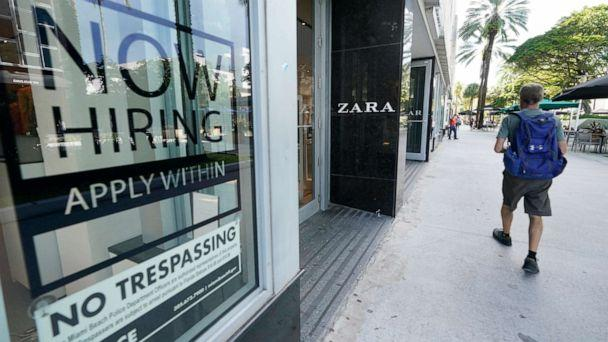 PHOTO: A pedestrian walks past a Zara store with a large 'Now Hiring,' sign in the window, Oct. 12, 2020, along the famed Lincoln Road area in Miami Beach, Fla. (Wilfredo Lee/AP, FILE)