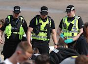Police at Portobello Beach in Edinburgh confiscating alcohol from beachgoers and breaking up large crowds who flocked to the beach to make the most of the good weather.