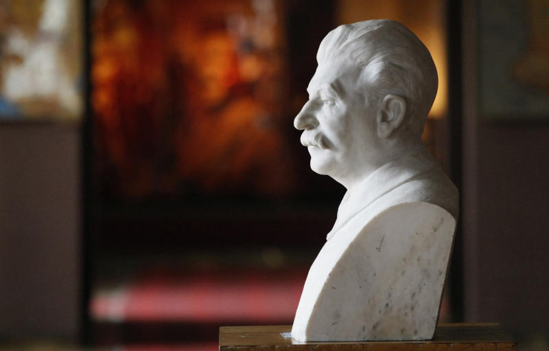 A bust of Soviet dictator Josef Stalin sits inside a museum dedicated to him in the town of Gori, some 80 kilometers (50 miles) west of the Georgian capital Tbilisi, Monday, April 9, 2012. A museum that has honored Josef Stalin in Georgia since 1937 is being remodeled to exhibit the atrocities that were committed during the Soviet dictator's rule. (AP Photo/Shakh Aivazov)