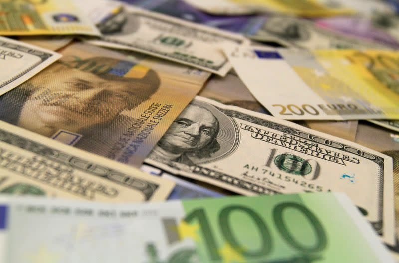 U.S. dollar, euro and Swiss franc bank notes are seen in a bank in Budapest