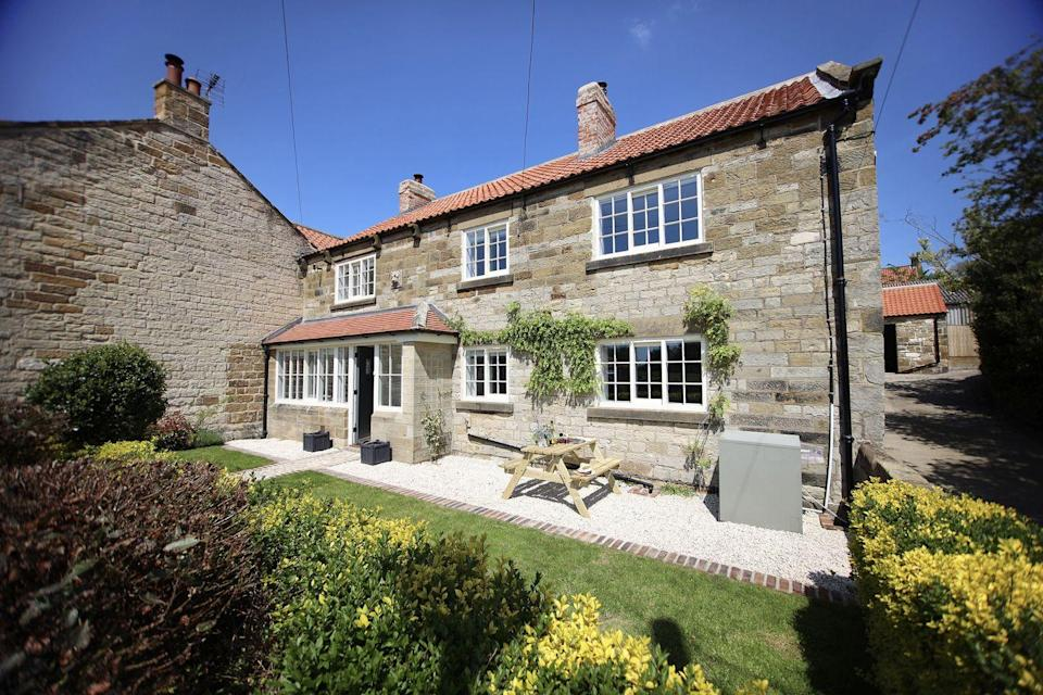 """<p>Escape to North Yorkshire for a luxurious family break at this stunning cottage in the small village of Osmotherley. <a href=""""https://www.holidayathome.co.uk/accommodation/paddock-view/"""" rel=""""nofollow noopener"""" target=""""_blank"""" data-ylk=""""slk:Paddock View"""" class=""""link rapid-noclick-resp"""">Paddock View</a> is a self-catering property from luxury cottage rental site Holiday at Home, which affords all the comforts of home, such as log burners, board games and a perfectly preened garden, alongside the unexpected touches you'd normally find in a hotel. </p><p>Here, you can enjoy spa-style robes, miniature toiletries and a rain shower in one of the bathrooms, as well as an AGA to entertain the family with delicious feasts. When the weather permits, you'll want to head out to the garden and fire up the pizza oven and BBQ. With enough room for eight, it's perfect for a multi-generational holiday. The grandparents will love relaxing in the pretty garden, while the teens won't get bored thanks to the table football and Xbox in the games room.</p><p>With Farrow & Ball paint, sumptuous beds and high-quality decor throughout (we love the kitchen island with bar stools and elegant dining room), this cottage was designed to impress the whole family, including furry members with four legs.</p><p>Nearby, there's an abundance of walking trails and beauty spots, like Cod Beck Reservoir. For days out, Whitby, York and Harrogate are worth considering when you're not soaking up the village atmosphere in Osmotherley.</p><p><a class=""""link rapid-noclick-resp"""" href=""""https://www.holidayathome.co.uk/accommodation/paddock-view/"""" rel=""""nofollow noopener"""" target=""""_blank"""" data-ylk=""""slk:CHECK AVAILABILITY"""">CHECK AVAILABILITY</a> </p>"""