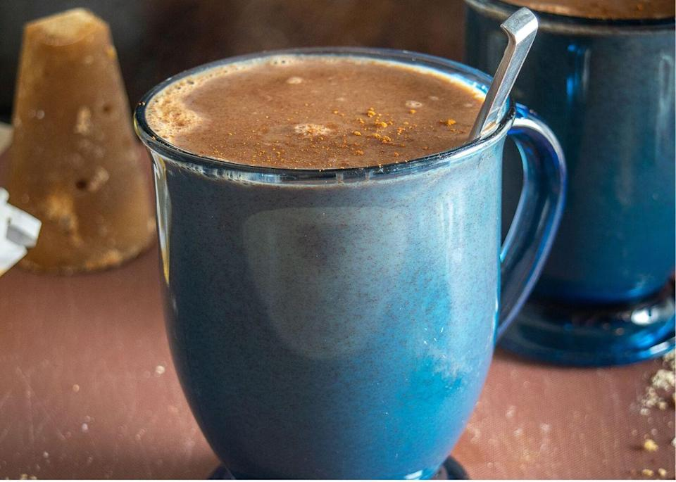 """<p>From chilled horchata to hot champurrado. This express edition uses rich Mexican chocolate and masa harina as a base. Chocolate is just one of several <a href=""""https://www.thedailymeal.com/healthy-eating/20-foods-and-drinks-you-didn-t-know-had-caffeine-slideshow?referrer=yahoo&category=beauty_food&include_utm=1&utm_medium=referral&utm_source=yahoo&utm_campaign=feed"""" rel=""""nofollow noopener"""" target=""""_blank"""" data-ylk=""""slk:foods you didn't know had caffeine"""" class=""""link rapid-noclick-resp"""">foods you didn't know had caffeine</a>, so swap out your morning coffee for this hearty replacement.</p> <p><strong><a href=""""https://www.thedailymeal.com/best-recipes/champurrado-express-atole?referrer=yahoo&category=beauty_food&include_utm=1&utm_medium=referral&utm_source=yahoo&utm_campaign=feed"""" rel=""""nofollow noopener"""" target=""""_blank"""" data-ylk=""""slk:For the Champurrado Express Edition recipe, click here."""" class=""""link rapid-noclick-resp"""">For the Champurrado Express Edition recipe, click here.</a></strong></p>"""
