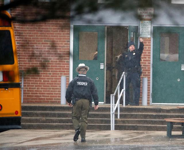 <p>A policeman gives a thumbs-up after moving students into a different area of Great Mills High School, the scene of a shooting, Tuesday morning, March 20, 2018 in Great Mills, Md. (Photo: Alex Brandon/AP) </p>