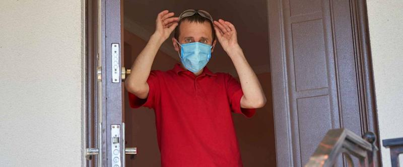 guy goes for a walk in a medical mask,young man leaves home in medical mask