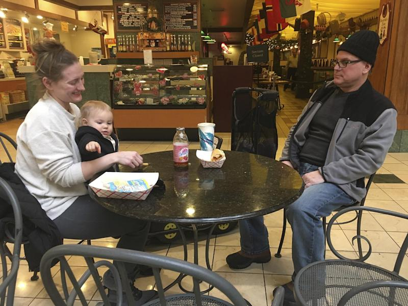 Stormy Patterson and her husband, Roger Kornfeind, get a bite to eat with their 16-month-old daughter Rowan at a mall in Whitehall, Pennsylvania, on February 9, 2017. Patterson has boycotted Hobby Lobby for years over the chain's stance on birth control, a phenomenon that seems to be gaining steam in the Donald Trump era as activists who either oppose or support the president target stores and brands for boycotts. (AP Photo/Michael Rubinkam)