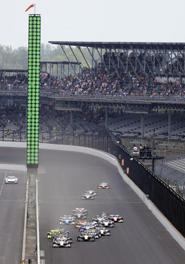 Will Power, of Australia, leads the field at the start of the IndyCar Grand Prix auto race at Indianapolis Motor Speedway, in Indianapolis Saturday, May 12, 2018. (AP Photo/Darron Cummings)