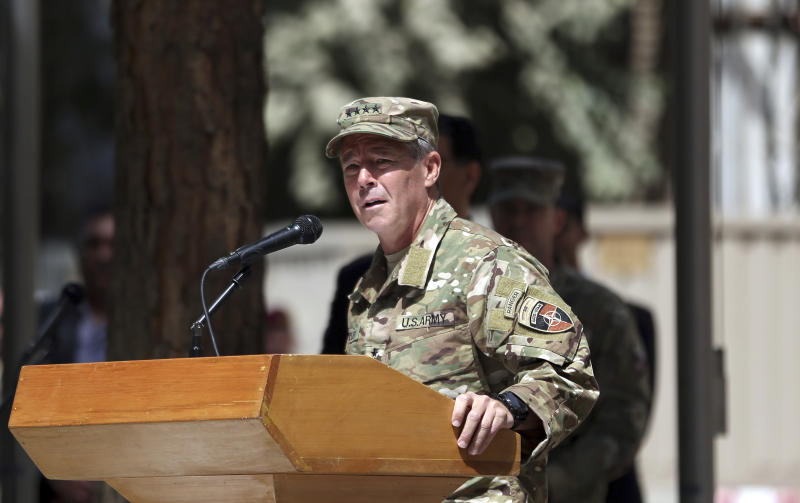 U.S. Army Gen. Austin Miller speaks during the change of command ceremony at Resolute Support headquarters in Kabul, Afghanistan, Sunday, Sept. 2, 2018. Miller assumed command of the 41-nation NATO mission in Afghanistan following a handover ceremony. (AP Photo/Massoud Hossaini)