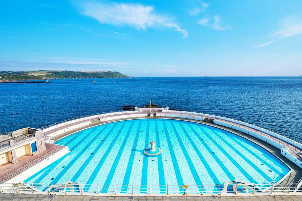 """<p><strong>Looks like: </strong>An infinity pool in Santorini</p><p>Voted one of the best pools in Europe, Plymouth's 1930s lido overlooks the ocean, offering a slice of bygone Art Deco glamour. While the Grade II listed pool is currently closed based on government regulations, but is expected to reopen later this summer. Looking out from the salt water pool on a warm day, you could easily be looking at the coast of a Greek island.<strong><br></strong></p><p><strong>Stay at: </strong>Continue your restful break at <a href=""""https://www.boringdonhall.co.uk/"""" rel=""""nofollow noopener"""" target=""""_blank"""" data-ylk=""""slk:Boringdon Hall Hotel"""" class=""""link rapid-noclick-resp"""">Boringdon Hall Hotel</a> which boasts a a multi-million, state-of-the-art spa in a historic setting.</p>"""