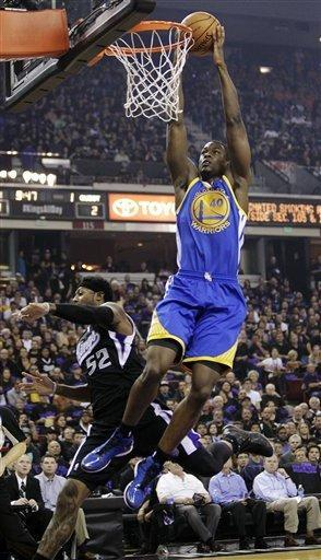 Golden State Warriors forward Harrison Barnes (40) dunks over Sacramento Kings forward James Johnson during the first quarter of an NBA basketball game in Sacramento, Calif., Monday, Nov. 5, 2012. (AP Photo/Rich Pedroncelli)