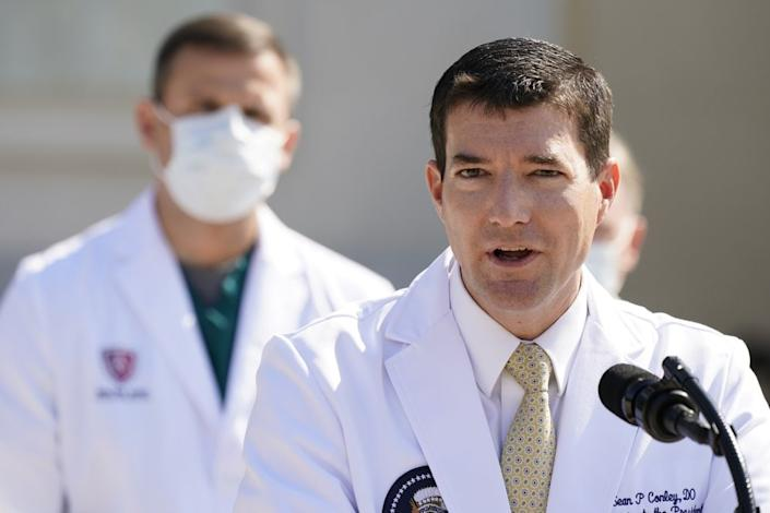 Dr. Sean Conley, physician to President Donald Trump, briefs reporters at Walter Reed National Military Medical Center in Bethesda, Md., Sunday, Oct. 4, 2020. Trump was admitted to the hospital after contracting the coronavirus. (AP Photo/Jacquelyn Martin)