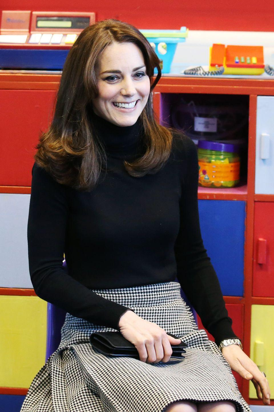 """<p>In accord with Scottish fashion, the Duchess also wore a kilt by new brand <a href=""""http://lekilt.co.uk/shop/classic-houndstooth-long"""" rel=""""nofollow noopener"""" target=""""_blank"""" data-ylk=""""slk:Le Kilt"""" class=""""link rapid-noclick-resp"""">Le Kilt</a>, as she made her first stop at St. Catherine's Primary School. </p>"""