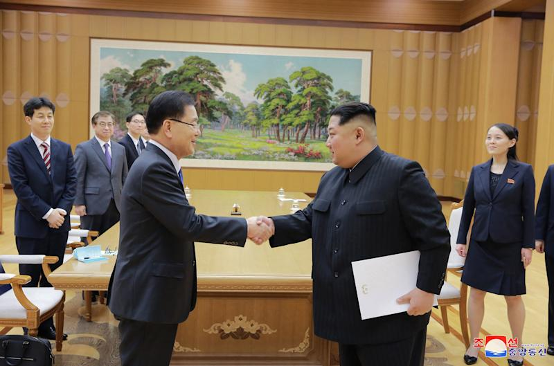"In this Monday, March 5, 2018 photo, provided by the North Korean government on March 6, North Korean leader Kim Jong Un, front right, shakes hands with South Korean National Security Director Chung Eui-yong after Chung gave Kim the letter from South Korean President Moon Jae-in, in Pyongyang, North Korea. Independent journalists were not given access to cover the event depicted in this image distributed by the North Korean government. The content of this image is as provided and cannot be independently verified. Korean language watermark on image as provided by source reads: ""KCNA"" which is the abbreviation for Korean Central News Agency. (Korean Central News Agency/Korea News Service via AP)"