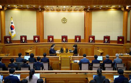 South Korean acting Constitutional Court's Chief Judge Lee Jung-mi (C) and seven judges during final ruling of President Park Geun-hye's impeachment at the Constitutional Court in Seoul, South Korea, 10 March 2017. REUTERS/Kim Min-hee/Pool