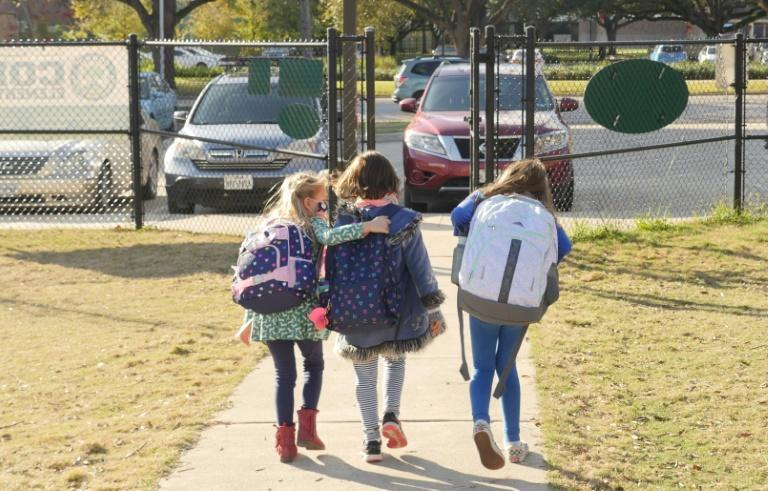Students leave an elementary school in the Texas town of Bellaire, near Houston on December 16, 2020 -- some schools are ending home-learning due to poor test results