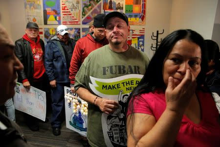 FILE PHOTO: Salvadoran immigrants prepare to exit after a media conference at the New York Immigration Coalition following US President Donald Trump's announcement to end the Temporary Protection Status for Salvadoran immigrants in Manhattan, New York