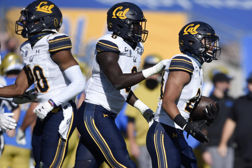 California cornerback Camryn Bynum, right, celebrates after intercepting a pass during the first half of an NCAA college football game against UCLA in Los Angeles, Sunday, Nov. 15, 2020. (AP Photo/Kelvin Kuo)