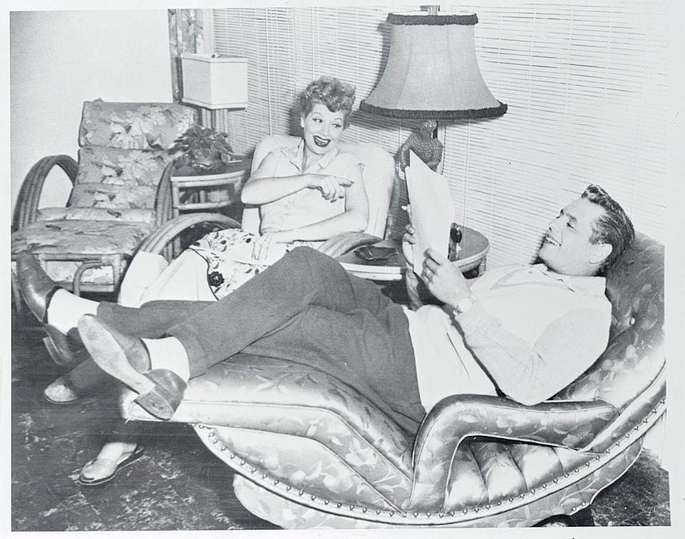 <p>Lucille and Desi relax on set while reviewing a script for that week's episode. Since the couple not only stared in <em>I Love Lucy</em>, but also produced it through their company, Desilu Productions, they had major control over the program. </p>