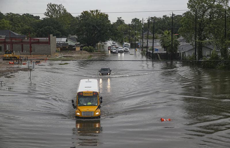 A school bus drives through floodwater in Houston, Texas: Getty Images