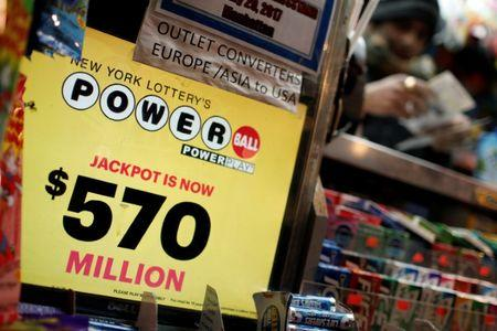 A vendor sells lottery tickets for the Powerball and Mega Millions draw at a news stand in midtown Manhattan in New York City, New York, U.S., January 5, 2018. REUTERS/Mike Segar