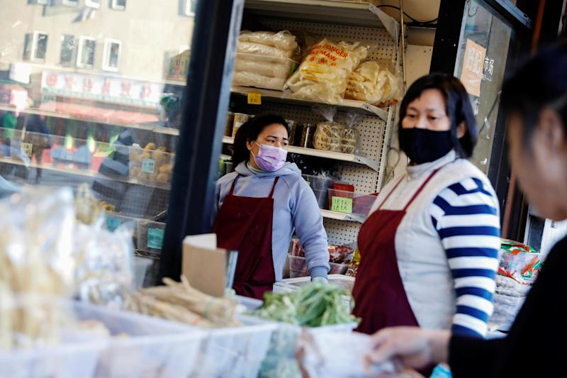 Employees at a market wear face masks in San Francisco, California: REUTERS