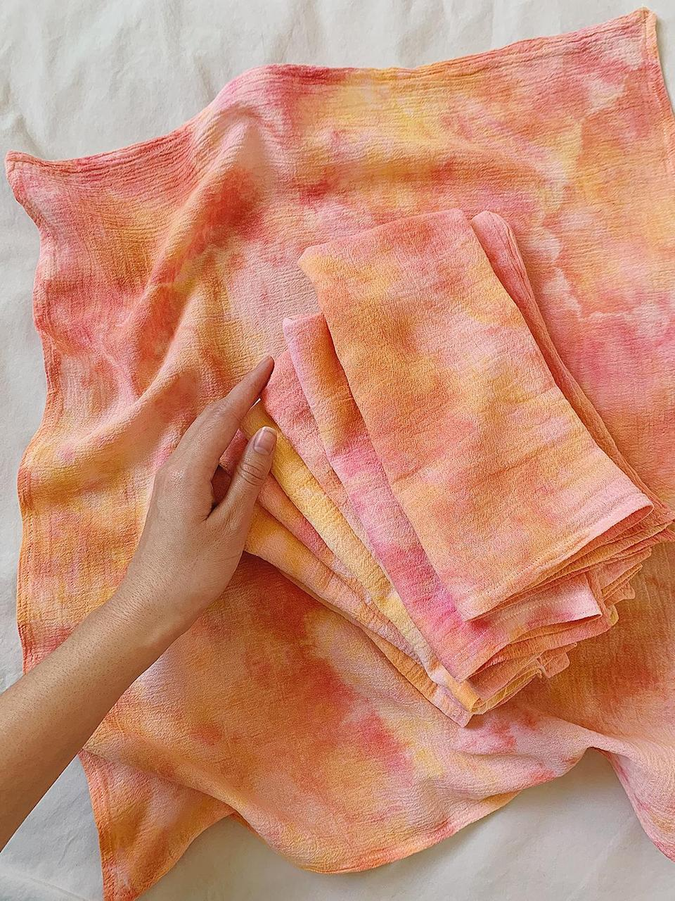 """<p>Cloth napkins are a clear signifier of adulting, if you ask us, but they can often feel too stiff or precious. Enter this whimsical tie-dye set from Etsy shop Apricot LA, which strikes the perfect balance of casual and elegant (not to mention eco-friendly). Available in a number of colorways, there's a handmade set to elevate all of the post-pandemic dinner parties you're dreaming of. </p> <p><strong>Buy It!</strong> $25 for 2, <a href=""""https://www.awin1.com/cread.php?awinmid=6220&awinaffid=272513&clickref=PEOGeniusHolidayGiftIdeasUnder25sdodd1271LifGal12372801202011I&p=https%3A%2F%2Fwww.etsy.com%2Flisting%2F769651316%2Fjuicy-handmade-cloth-napkins%3Fref%3Dshop_home_active_14"""" rel=""""nofollow noopener"""" target=""""_blank"""" data-ylk=""""slk:etsy.com"""" class=""""link rapid-noclick-resp"""">etsy.com</a></p>"""
