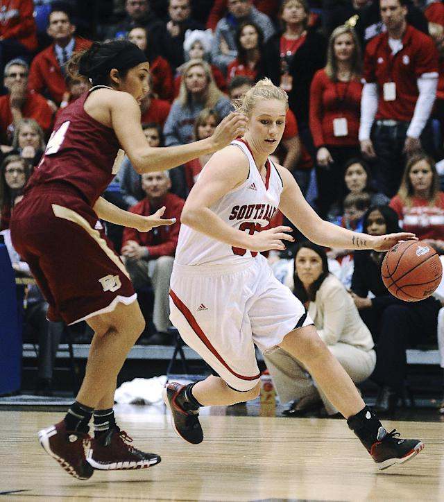 South Dakota's Nicole Seekamp (35) drives past Denver's Kailey Edwards during the second half of an NCAA college basketball game for the championship of the Summit League women's tournament Tuesday, March 11, 2014, in Sioux Falls, S.D. South Dakota won 82-71. (AP Photo/Argus Leader, Joe Ahlquist)
