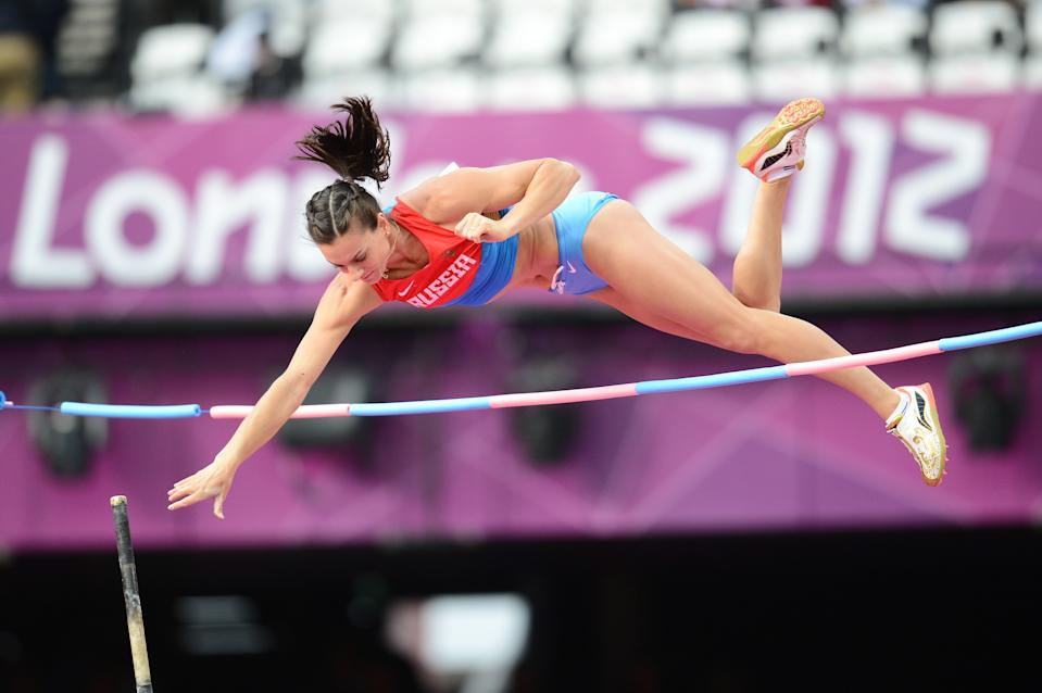 Russia's Yelena Isinbayeva practices ahead of the women's pole vault final at the athletics event of the London 2012 Olympic Games on August 6, 2012 in London.   AFP PHOTO / FRANCK FIFE        (Photo credit should read FRANCK FIFE/AFP/GettyImages)