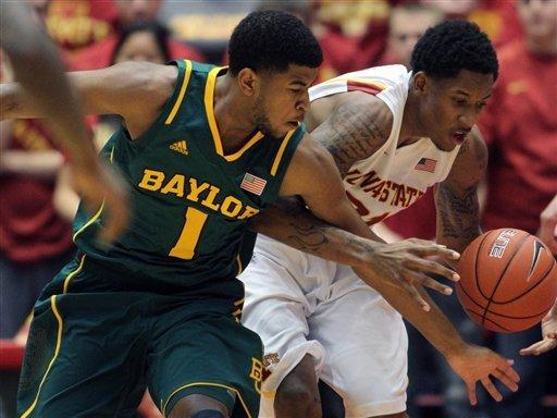 Baylor guard L.J. Rose (1) and Iowa State guard Will Clyburn (21) fight for control of a loose ball in the first half of an NCAA college basketball game Saturday, Feb. 2, 2013, at Hilton Coliseum in Ames, Iowa. (AP Photo/Justin Hayworth)