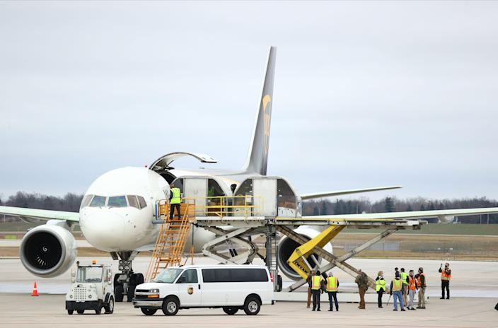 Shipments of the Pfizer-BioNTech COVID-19 vaccine are loaded into a UPS plane on December 13, 2020 in Lansing, Michigan.