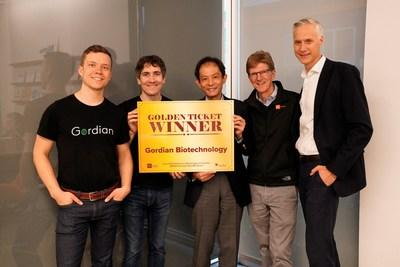 The Gordian Biotechnology team accepts the Astellas Golden Ticket from MBC BioLabs during the event on December 4, 2019