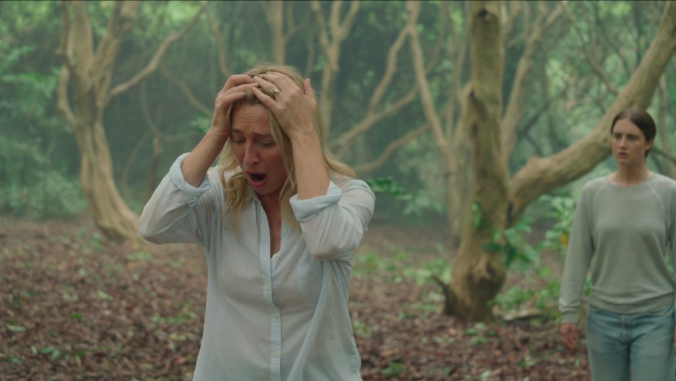Asher's character holding her hands to her head in anguish
