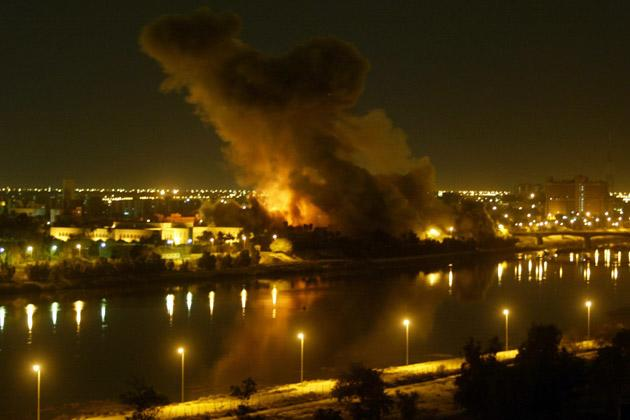 File picture dated March 20, 2003 shows smoke billowing after a missile hit the planning ministry in Baghdad as the Iraqi capital came under heavy US-led bombardment on the first day of the US-led invasion of Iraq that toppled Saddam Hussein. The war which aimed to enshrine a liberal democracy in the heart of the Middle East ten years ago, unleashed sectarian violence and endless political disputes instead.