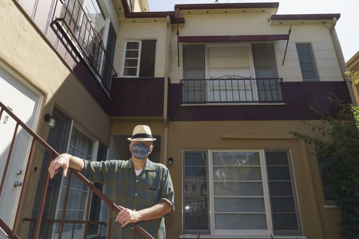 Nathan Long, a video game writer, poses for a picture outside his rental apartment courtyard in Glendale, Calif., Thursday, April 8, 2021. He and his wife, Lili, have been unsuccessful so far in their search for a home in Los Angeles. (AP Photo/Damian Dovarganes)