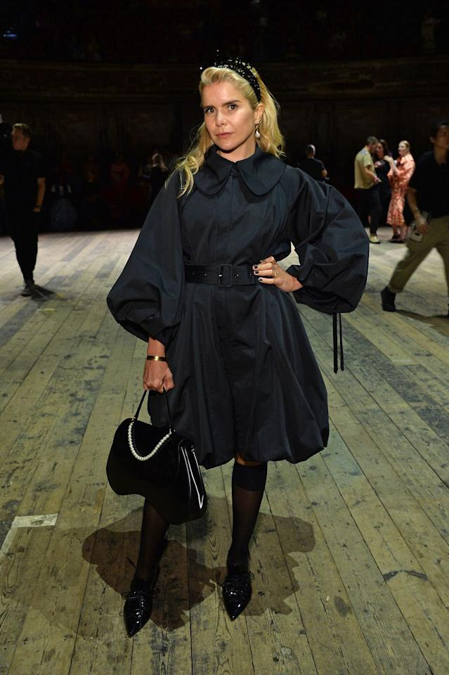 <p>The singer went for an all-black ensemble for the Simone Rocha shoe, dressed in a balloon-sleeved puffball dress, black stockings, black heels and a black headband. </p>