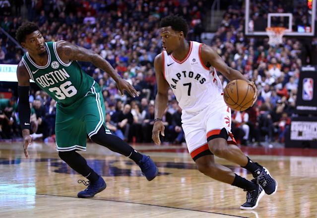 Kyle Lowry #7 of the Toronto Raptors dribbles the ball as Marcus Smart #36 of the Boston Celtics defends on February 26, 2019 in Toronto, Canada. (Photo by Vaughn Ridley/Getty Images)