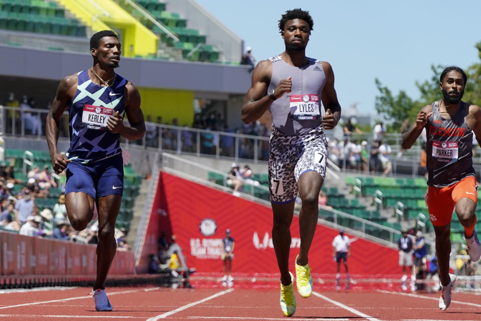 Noah Lyles competes in the first heat of the men's 200-meter run at the U.S. Olympic Track and Field Trials Friday, June 25, 2021, in Eugene, Ore. (AP Photo/Ashley Landis)